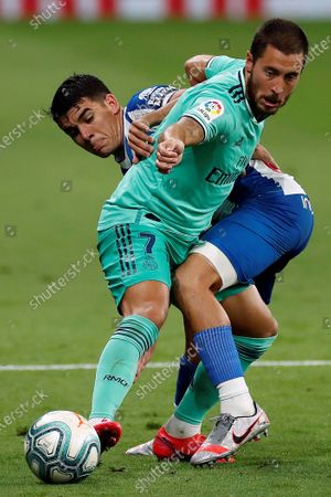 Real Madrid's Eden Hazard (front) in action against Victor Gomez (back) of RCD Espanyol during the Spanish LaLiga soccer match between RCD Espanyol and Real Madrid held at RCDE Stadium, in Barcelona, Spain, 28 June 2020.