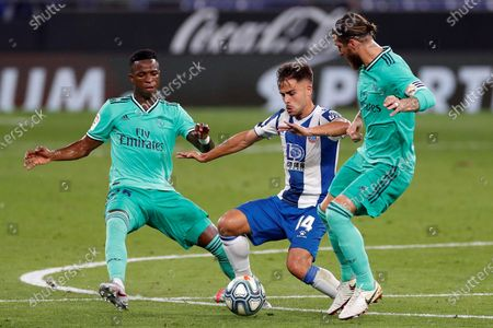 RCD Espanyol's Oscar Melendo (C) in action against Vinicius Jr. (L) and Sergio Ramos (R) of Real Madrid during the Spanish LaLiga soccer match between RCD Espanyol and Real Madrid held at RCDE Stadium, in Barcelona, Spain, 28 June 2020.