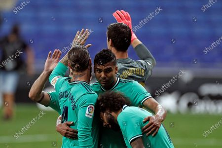 Real Madrid's players celebrate their victory against RCD Espanyol after the Spanish LaLiga soccer match between RCD Espanyol and Real Madrid held at RCDE Stadium, in Barcelona, Spain, 28 June 2020.