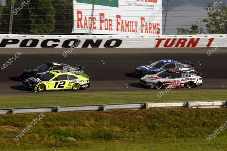 Ryan Blaney (12), Kurt Busch (1), Cole Custer (41) and Chris Buescher (17) go through Turn 1 as racing resumes after a rain delay during a NASCAR Cup Series auto race at Pocono Raceway, in Long Pond, Pa