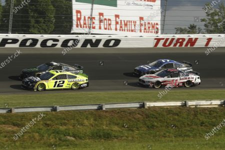 Ryan Blaney (12), Kurt Busch (1), Cole Custer (41) and Chris Buescher (17) go through turn one as green flag racing resumes after a rain delay during the NASCAR Cup Series auto race at Pocono Raceway, in Long Pond, Pa