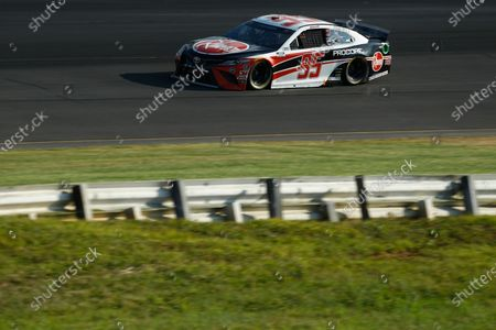 Christopher Bell competes in the NASCAR Cup Series auto race at Pocono Raceway, in Long Pond, Pa