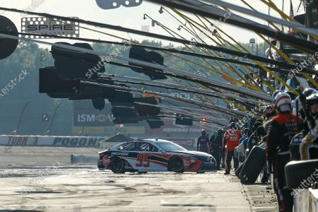 Christopher Bell gets his car sideways coming in to pit during the NASCAR Cup Series auto race at Pocono Raceway, in Long Pond, Pa