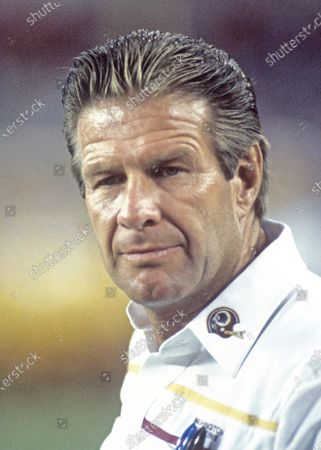Stock fotografie na téma Washington Redskins offensive line coach Joe Bugel on the sidelines during a pre-season game against the Miami Dolphins at RFK Stadium in Washington, D.C.. The Redskins won the game 35 - 21.