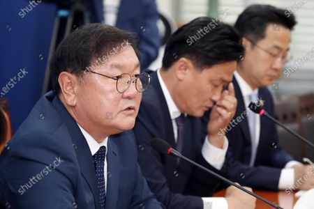 Stock Picture of South Korea's Rep. Kim Tae-nyeon (L), floor leader of the ruling Democratic Party, speaks at a press conference in Seoul, South Korea, 29 June 2020. Kim failed to strike a deal with his main opposition counterpart on how to divide the chairmanship of the National Assembly's standing committees and especially which party will have the chairmanship of the legislation and judiciary committee.