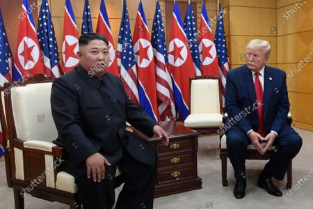 President Donald Trump, right, listens as North Korean leader Kim Jong Un, left, speaks during their bilateral meeting inside the Freedom House at the border village of Panmunjom in the Demilitarized Zone, South Korea. Trump is still waiting for his two years of one-on-one diplomacy with Kim Jong Un to pay off with a deal that eliminates the threat of North Korea's nuclear weapons