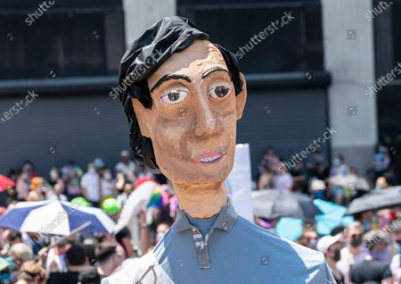 Atmosphere at queer liberation march and rally for black lives and against police brutality at Foley Square and Chambers street. Pride parade was cancel this year because of COVID-19 pandemic. Gay and transgender people gather for march and rally to celebrate 50th anniversary of Stonewall uprising and in support of Black LIves Matter movement. Pride Puppets seen by artist Chris Williams who created some puppets in the likes of Marsha P. Johnson, Sylvia Rivera, Billy Porter, Laverne Cox, Janelle Monae.