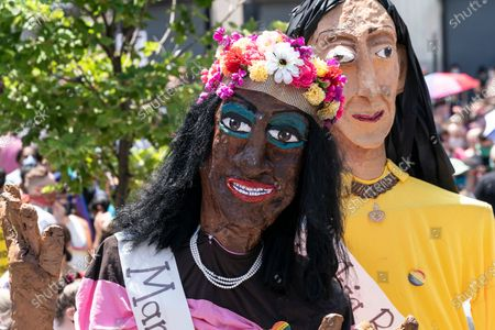 Stock Picture of Atmosphere at queer liberation march and rally for black lives and against police brutality at Foley Square and Chambers street. Pride parade was cancel this year because of COVID-19 pandemic. Gay and transgender people gather for march and rally to celebrate 50th anniversary of Stonewall uprising and in support of Black LIves Matter movement. Pride Puppets seen by artist Chris Williams who created some puppets in the likes of Marsha P. Johnson, Sylvia Rivera, Billy Porter, Laverne Cox, Janelle Monae.