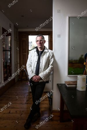 Tim Crosland, Plan B. Earth lawyer is seen being photographed at his home.