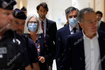 Former French Prime Minister Francois Fillon (C-R) and his wife Penelope (C-L) arrive at the courthouse in Paris, France, 29 June 2020. The French court is scheduled to give its verdict in the trial of the ex-prime minister, accused of employing his wife Penelope as a highly-paid aide for years despite the lack of evidence that she performed any legitimate work.