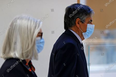 Former French Prime Minister Francois Fillon (R) and his wife Penelope (L) arrive at the courthouse in Paris, France, 29 June 2020. The French court is scheduled to give its verdict in the trial of the ex-prime minister, accused of employing his wife Penelope as a highly-paid aide for years despite the lack of evidence that she performed any legitimate work.