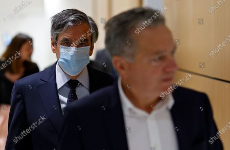 Former French Prime Minister Francois Fillon (L) and his wife Penelope (unseen) arrive at the courthouse in Paris, France, 29 June 2020. The French court is scheduled to give its verdict in the trial of the ex-prime minister, accused of employing his wife Penelope as a highly-paid aide for years despite the lack of evidence that she performed any legitimate work.