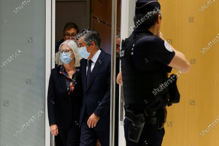 Stock Image of Former French Prime Minister Francois Fillon (C) and his wife Penelope (L) leave the courthouse after the announcement of the verdict in Paris, France, 29 June 2020. Francois Fillon was sentenced to 5 years in prison, with two of them effectives during his trial, accused of employing his wife Penelope as a highly-paid aide for years despite the lack of evidence that she performed any legitimate work.