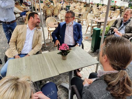 Brugge Mayor Dirk De Fauw (C) pictured on a terrace, Monday 29 June 2020, in Brugge. Mayor De Fauw was stabbed on June 20 outside his office in Brugge. Police arrested a suspect.