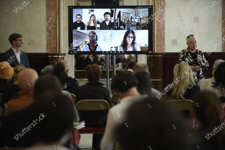 Journalists attend a video press conference with artists such as French band 'La Horde' and Malian singer and composer Rokia Traore, for the presentation of the first digital festival 'Festival apres demain' (lit. Festival after tomorrow) at the Chatelet theater in Paris, France, 29 June 2020. The festival will run from the 02 to 12 July 2020.