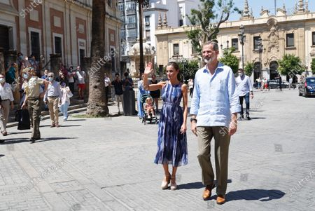 """Stock Picture of Queen Letizia and King Felipe VI of Spain tour the """"Tres Mil Viviendas"""" neighborhood on June 29, 2020 in Sevillla, Spain. The kings make a tour of various autonomous communities supporting economic, social and cultural activity after the coronavirus outbreak."""