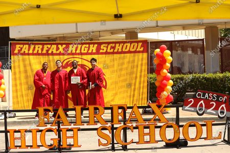 LOS ANGELES, CA - JUNE 15, 2020 - - Graduates Ayden Wright, 19, from left, Addam Saavedra, 19, Jordan Reed, 18, and Christopher Rosales, 18, have their photo made during a drive-by graduation ceremony at Fairfax High School in Los Angeles on June 15, 2020. Due to the coronavirus pandemic most high school graduations use the drive-by method to prevent further infection. (Genaro Molina / Los Angeles Times)