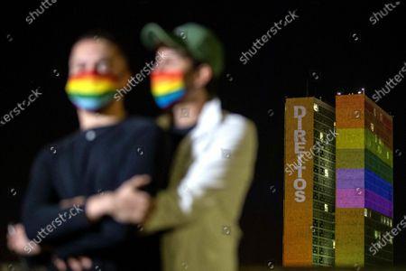 Editorial image of Rainbow flag colors of the illuminate the headquarters of the Brazilian Congress, Brasilia, Brazil - 29 Jun 2020