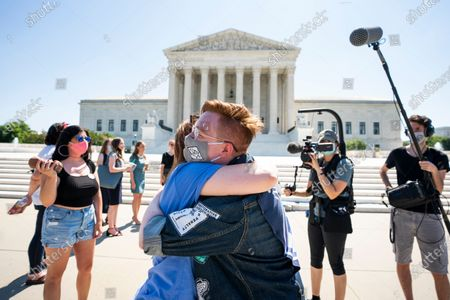 Anti-abortion protesters embrace each other outside the Supreme Court of the United States after it struck down a controversial Louisiana state abortion law in Washington, DC, USA, 29 June 2020. Chief Justice John Roberts voted with the top court's four liberal justices in a 5-4 ruling that declared the law - which was passed in 2014 and required physicians to have active admitting privileges at a hospital near the facility where they provide abortions - unconstitutional. SCOTUS has yet to rule on another high-profile case involving the disclosure of President Donald Trump's financial records and tax returns.