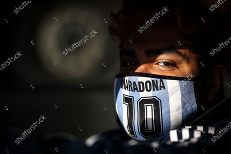 Stock Image of A man wears a mask of Diego Maradona in Buenos Aires, Argentina, 29 June 2020.