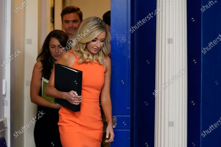White House press secretary Kayleigh McEnany arrives to speak during a press briefing at the White House, in Washington