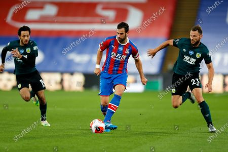 Stock Image of Selhurst Park, London, England; James Tomkins of Crystal Palace passing the ball; English Premier League Football, Crystal Palace versus Burnley Football Club.