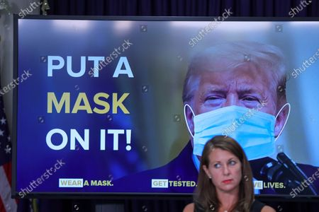 New York Governor Andrew Cuomo displays an image of President Donald Trump during a news conference on the new coronavirus (COVID-19)on Manhattan Island in New York City