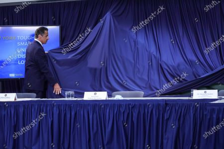 New York Governor Andew Cuomo presents a model of a mountain that represents a graph of falling contamination during a press conference on the new coronavirus (COVID-19)on Manhattan Island in New York City