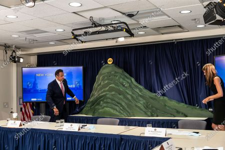 NYS Governor Andrew Cuomo makes an announcement and holds media briefing at 3rd Avenue office. Cuomo and secretary to the Givernor Melissa DeRosa unveiled green topographic sculpture model of COVID-19 hospitalization curve from day 1 till day 111. This is the mountain that New Yorkers climbed before the hospitalization curve plateaued after 42 days he said during briefing.