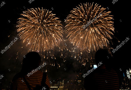 Macy's holds the first of six July 4 firework displays on the East River by Long Island City in New York. The 5 minute display was at a location kept top secret in an effort to minimize crowds gathering in the midst of the Coronavirus pandemic.