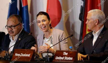 New Zealand Prime Minister Jacinda Ardern, center, gestures beside U.S. Vice President Mike Pence, right, and Papua New Guinea Prime Minister Peter O'Neill during the Leaders Electrification Project meeting as part of the APEC 2018 at Port Moresby, Papua New Guinea. New Zealand, canceled its plans to host a major meeting of U.S. and Asian leaders next year because of the coronavirus, opting instead to lead a virtual summit