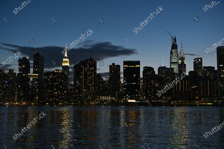 Macy's holds the first of six July 4 firework displays on the East River by Long Island City in New York.