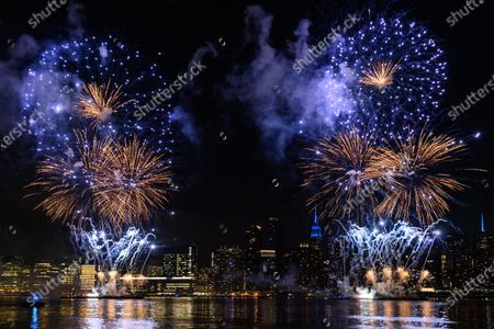 Stock Picture of Macy's holds the first of six July 4 firework displays on the East River by Long Island City in New York.