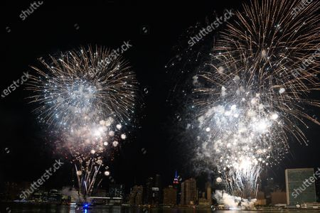 Stock Photo of Macy's holds the first of six July 4 firework displays on the East River by Long Island City in New York.