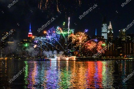 Stock Image of Macy's holds the first of six July 4 firework displays on the East River by Long Island City in New York.