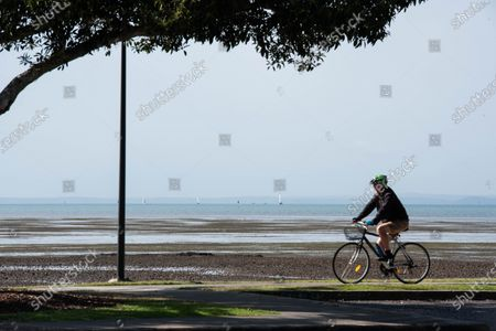 A cyclist enjoys a sunny day on the Bayside amid Covid-19 crisis Queensland Premier Annastacia Palaszczuk takes part of a state's cabinet meeting on Tuesday 30 June to announce possible border reopening and health recommendations.