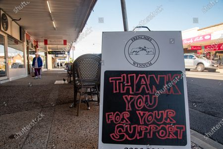A cafe has a sign displayed saying 'Thank you for your support' amid Covid-19 crisis. Queensland Premier Annastacia Palaszczuk takes part of a state's cabinet meeting on Tuesday 30 June to announce possible border reopening and health recommendations.