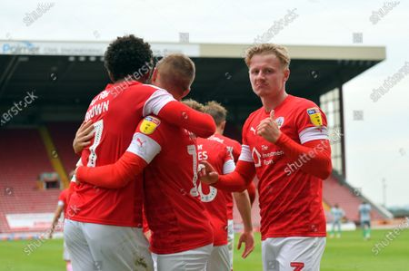 Barnsley's Jacob Brown celebrates his goal, Ben Williams punches the air.