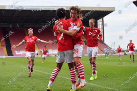 Barnsley's Jacob Brown celebrates his goal with Callum Style's