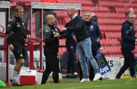 Barnsley's Gerhard Struber (jeans), celebrates at full time with coach Adam Murray.
