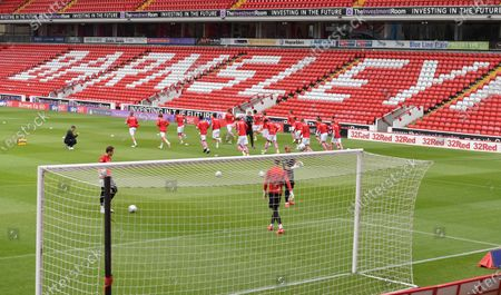 Barnsley warm up in front of the East stand.