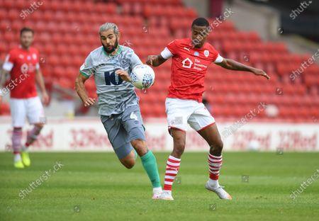 Barnsley's Elliot Simoes with Blackburn's Bradley Johnson.