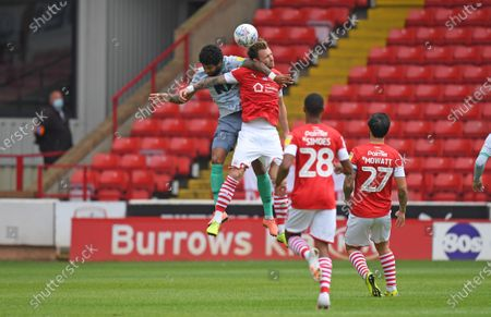 Barnsley's Michael Sollbauer feels the force of Blackburn's Dominic Samuel.