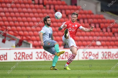 Barnsley's Michael Sollbauer tackles Blackburn's Adam Armstrong.