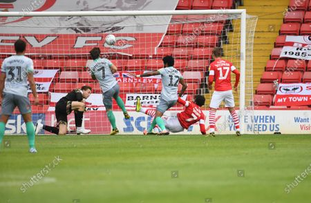 Barnsley's Jacob Brown makes a last ditch challenge to deny Dominic Samuel a goal.