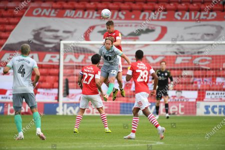 Barnsley's Mads Anderson climbs above Lewis Holtby.