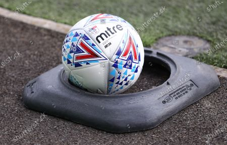 A disinfected ball waits in a cone by the side of the pitch