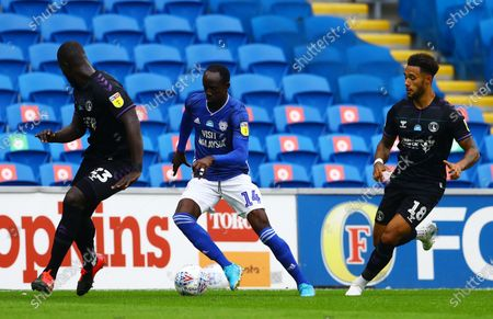 Albert Adomah of Cardiff City and Andre Green of Charlton Athletic.