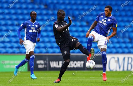 Mouhamadou-Naby Sarr of Charlton Athletic and Nathaniel Mendez-Laing of Cardiff City.