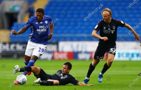 Nathaniel Mendez-Laing of Cardiff City is tackled by Josh Cullen of Charlton Athletic.
